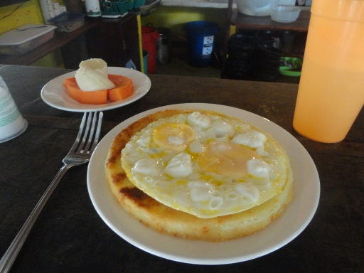 The common Colombian breakfast of arepas (thick corn tortillas) and eggs