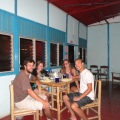 My San Juan del Sur gang, at our hostel, sitting down to a meal of sweet curry