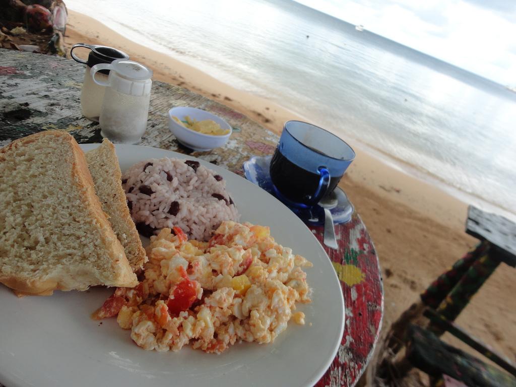 Coconut bread, scrambled eggs, gallo pinto--breakfast on Little Corn