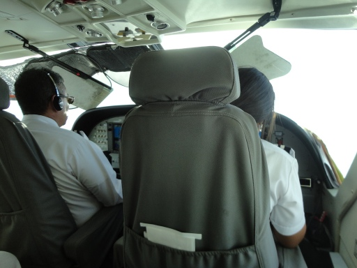 Sitting next to the pilots on the way back from Little Corn