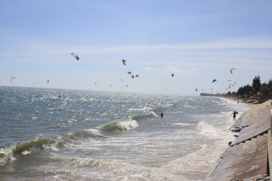 Wind surfers along Mui Ne beach